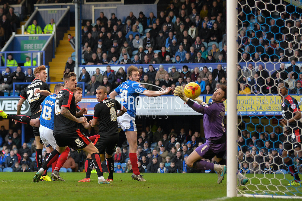 Portsmouth defender Matt Clarke makes it 1-0 with a header from a corner during the Sky Bet League 2 match between Portsmouth and Crawley Town at Fratton Park, Portsmouth, England on 2 January 2016. Photo by Adam Rivers.
