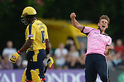 Middlesex bowler Harry Podmore celebrates the wicket of Michael Carberry during the NatWest T20 Blast South Group match between Middlesex County Cricket Club and Hampshire County Cricket Club at Uxbridge Cricket Ground, Uxbridge, United Kingdom on 27 May 2016. Photo by David Vokes.