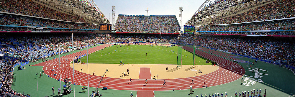 A panoramic view inside the Olympic Stadium during daytime competition of the Men's 400m Round 1 heat 1 during the Sydney Olympic Games 2000...Panoramic images from the Sydney Olympic Games, Sydney, Australia.  2000 . Photo Tim Clayton