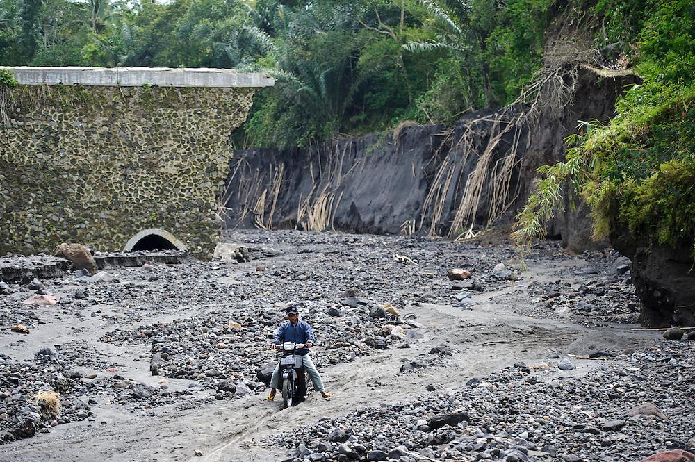 A gorge cut by lahar mud flows, Gunung Merapi, Umbulharjo, Java, Indonesia.