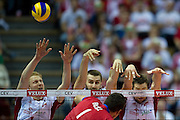 (L-R) Jakub Jarosz and Marcin Mozdzonek and Michal Kubiak all from Poland in action during the 2013 CEV VELUX Volleyball European Championship match between Poland v Slovakia at Ergo Arena in Gdansk on September 22, 2013.<br /> <br /> Poland, Gdansk, September 22, 2013<br /> <br /> Picture also available in RAW (NEF) or TIFF format on special request.<br /> <br /> For editorial use only. Any commercial or promotional use requires permission.<br /> <br /> Mandatory credit:<br /> Photo by &copy; Adam Nurkiewicz / Mediasport