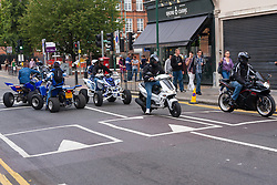 London, August 24th 2014. Bikers roar up and down Chamberlayne road minutes before a serious accident which involved police, fire and ambulance teams after a biker appeared to run into the back of a car
