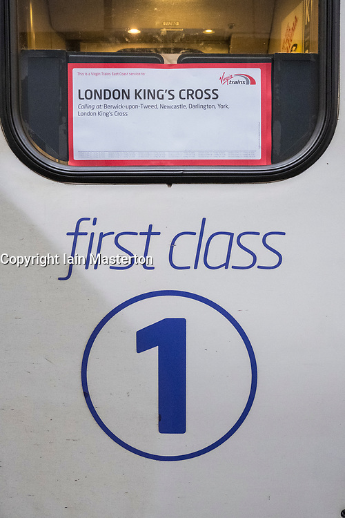Detail of First Class door on Virgin Trains locomotive from London King's Cross on East Coast Main line  at platform at Waverley Station in Edinburgh, Scotland, United Kingdom