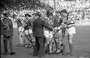 All Ireland Hurling Finals.1986..07.09.1986..09.07.1986..7th September 1986..September,every year,is the highlight of the GAA calendar with The All Ireland Finals being held in both codes. The senior and minor finals in each code are both played for on the same day. Each finalist has battled through provinical and knock out stages to reach the final.It is widely regarded as the pinnacle of a players career to reach and win an All Ireland Championship..In this years hurling finals,Cork played Offaly in the minor championship and a much fancied Galway team took on Cork in the senior final. Both matches were well fought and close encounters...In the senior hurling final Cork emerged victorious with a score of 4.13 (25) to Galways' 2.15 (21). .Photograph of the Cork senior hurling team being introduced to The President of Ireland Dr Patrick Hillery, by Cork captain,Tom Cashman..