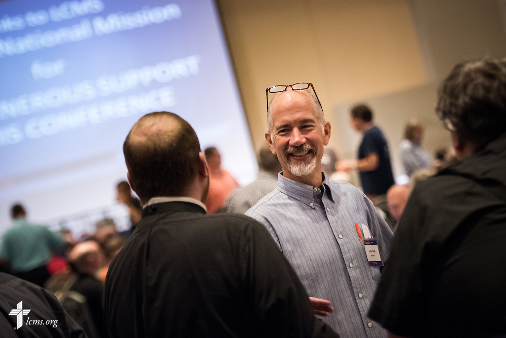 "The Rev. John Gutz, pastor of Holy Trinity Lutheran Church in Streator, Ill., greets other pastors during the DOXOLOGY event, ""Finding Our Voice,"" on Wednesday, August 12, 2015, at Saint Louis University in Midtown St. Louis. LCMS Communications/Erik M. Lunsford"