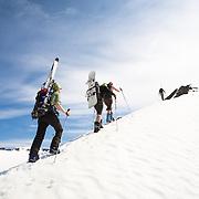 Skiers ascending mt. 1124m. Flateyjardalur, Iceland.