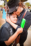 14 MARCH 2011 - PHOENIX, AZ: A woman comforts her son during an immigrants' rights protest at the Arizona State Capitol in Phoenix Monday. Protests by immigrants' rights activists have continued as the state's conservative Republican legislators debate toughening the state's anti-immigrant bills. Some of the bills the state legislature has debated this year include eliminating birthright citizenship, a law that would require hospitals to check the immigration status of patients checking in for elective care, a bill that would require schools to verify the immigration status of students when they enroll and a bill that would require law enforcement to impound the cars of undocumented immigrants even if they have a legal driver's license from another state.      Photo by Jack Kurtz