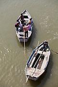 row boats on the Ganges River at the holy city of Garhmukteshwar, Uttar Pradesh, India