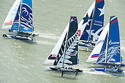 The Wave Muscat, Emirates Team New Zealand, Realstone and Gazprom Team Russia.  Day four of the Extreme Sailing Series regatta being sailed in Singapore. 23/2/2014
