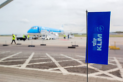 Inverness Airport welcomed KLM's Inaugural flight from Amsterdam. To celebrate the new route, the first flight from Schiphol, Amsterdam was greeted by a water cannon salute upon arrival.  On board were Barry ter Voert, Senior Vice President, Air France KLM European Markets and Wilco Swejen, Director for Aviation Marketing, Schipol Airport.  Provost Helen Carmichael, The Highland Council, Inglis Lyon, Managing Director of Highlands and Islands Aiports and Drew Hendry MP (Inverness, Nairn, Badenoch and Strathspey) met the delegation, officially welcoming the group to the Highlands. <br /> <br /> Pictured: COMPOSITE IMAGE<br /> <br /> Malcolm McCurrach | EEm | Tue, 17, May, 2016