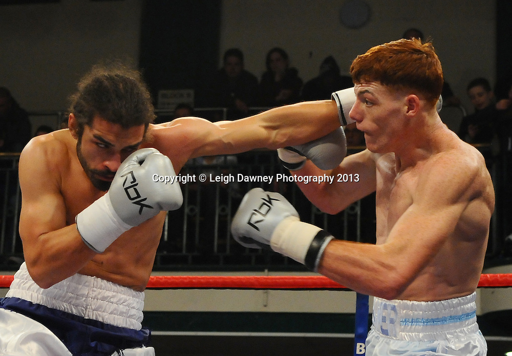 Tom Baker (white shorts) defeats Jason Ball at York Hall, Bethnal Green, London, UK on the 21st March 2013. Frank Warren Promotions. © Leigh Dawney Photography 2013.