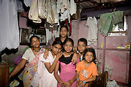 Anandi Anand Maraye and her family.  Dharavi, Mumbai, India