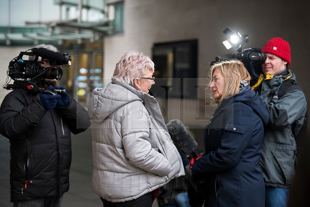 © Licensed to London News Pictures. 08/01/2018. London, UK. Former China editor for the BBC, CARRIE GRACIE (centre)  seen talking to media as she leaves BBC broadcasting House in London. CARRIE GRACIE resigned form her post as China editor and wrote an open letter to licence fee payers   in protest over unequal pay between men and women at the broadcasting corporation. Photo credit: Ben Cawthra/LNP
