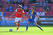 Rotherham United player Matt Crooks  and Shrewsbury Town player Oliver Norburn (8) during the EFL Sky Bet League 1 match between Rotherham United and Shrewsbury Town at the AESSEAL New York Stadium, Rotherham, England on 21 September 2019.