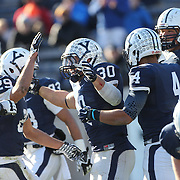 Yale running back Tyler Varga, (centre),  is congratulated by team mates after scoring a touchdown during the Yale Vs Princeton, Ivy League College Football match at Yale Bowl, New Haven, Connecticut, USA. 15th November 2014. Photo Tim Clayton