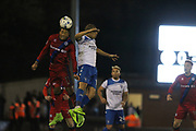 Nathaniel Mendez-Laing wins a header during the EFL Sky Bet League 1 match between Bury and Rochdale at the JD Stadium, Bury, England on 13 April 2017. Photo by Daniel Youngs.