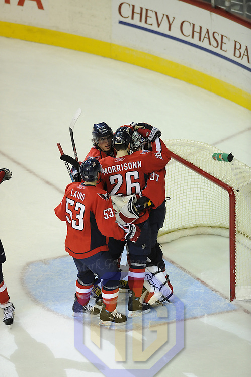 26 December 2007:  The Washington Capitals celebrate their 3-2 win over the Tampa Bay Lightning at the Verizon Center in Washington, D.C.  Joining in the celebration are Washington Capitals left wing Quintin Laing (53), left wing Alexander Ovechkin (C), goalie Olaf Kolzig (37), and defenseman Shaone Morrisonn (26).