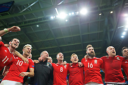 LILLE, FRANCE - Friday, July 1, 2016: Wales players celebrate in the team huddle following a 3-1 victory over Belgium and reaching the Semi-Final during the UEFA Euro 2016 Championship Quarter-Final match at the Stade Pierre Mauroy. Gareth Bale, Aaron Ramsey, goalkeeping coach Martyn Margetson, Andy King, George Williams, Joe Ledley, David Cotterill. (Pic by David Rawcliffe/Propaganda)