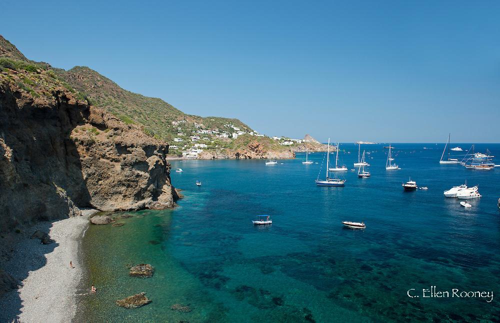 Yachts in a bay near Punta Milzzese on Panarea, The Aeolian Islands, Messina Province, Sicily, Italy
