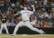 Jul 10, 2013; Phoenix, AZ, USA;  Los Angeles Dodgers pitcher Hyun-Jin Ryu (99) pitches against the Arizona Diamondbacks in the first inning at Chase Field. Mandatory Credit: Jennifer Stewart-USA TODAY Sports