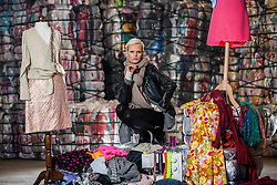 Model Anna Freemantle showing fashion students about upcycling clothes, at the UK&rsquo;s second largest textile recycling facility, Nathan&rsquo;s Wastesavers, in Denny.<br /> &copy; Michael Schofield.