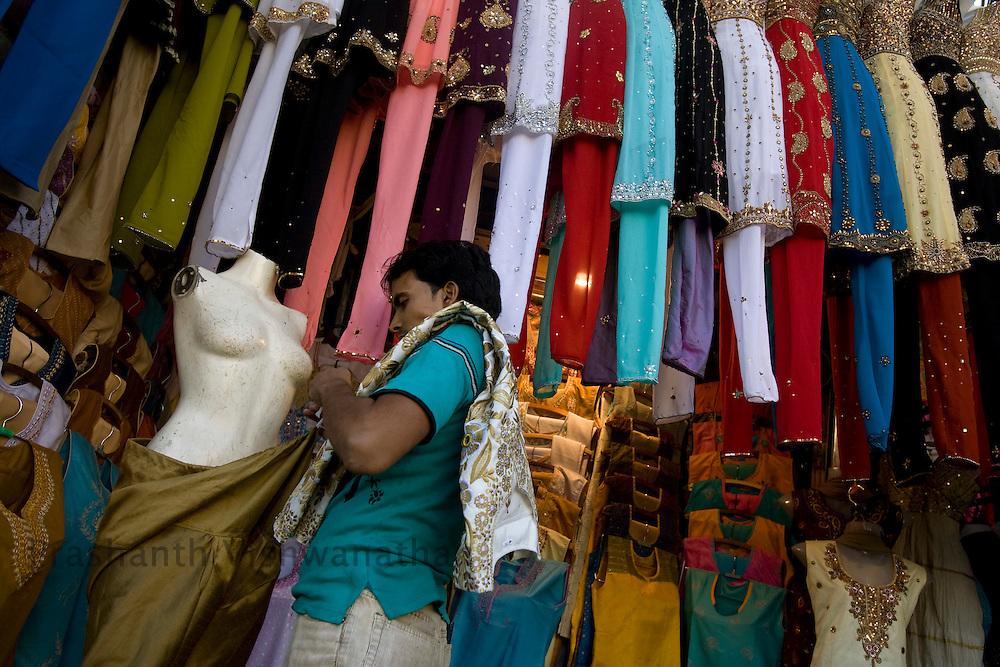 A shopkeeper arranges his stall on a street in Mumbai, on Sunday Dec. 28, 2008.  Photographer:Prashanth Vishwanathan