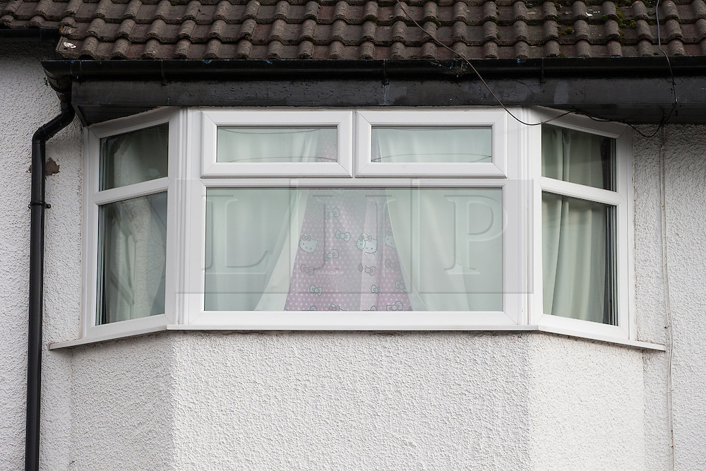 © Licensed to London News Pictures . 17/01/2015 . Stockport , UK . Front upstairs window with curtains drawn at 28 Meadway Road , Cheadle Hulme , Stockport this afternoon (Saturday 17th January 2015 ) after a man and a woman in their 40s were found dead inside last night (16th January 2015) . Neighbours describe the residents as a couple who have a young daughter . Photo credit : Joel Goodman/LNP