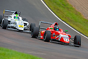 Abbie Munro (GBR) of Arden Motorsport exits Butchers, closely followed by Roberto Faria (BRA) of Fortec Motorsport during Round 23 of the FIA Formula 4 British Championship at Knockhill Racing Circuit, Dunfermline, Scotland on 15 September 2019.
