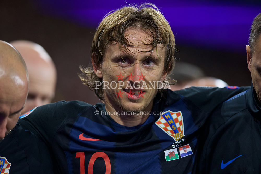 CARDIFF, WALES - Sunday, October 13, 2019: Croatia's captain Luka Modrić is helped off the pitch with an injury during the UEFA Euro 2020 Qualifying Group E match between Wales and Croatia at the Cardiff City Stadium. (Pic by Laura Malkin/Propaganda)