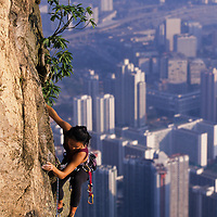 Olivia Hsu climbs on Lion Rock high above Hong Kong