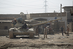 November 11, 2016 - Mosul, Nineveh, Iraq - 11/11/2016. Mosul, Iraq. A T-72 tank, belonging to the Iraqi Army's 9th Armoured Division, wait in Mosul's Hay Intisar district on the south east of the city. The district was taken by Iraqi Security Forces (ISF) around a week ago and, despite its proximity to ongoing fighting between ISF and ISIS militants, many residents still live in the settlement...The battle to retake Mosul, which fell June 2014, started on the 16th of October 2016 with Iraqi Security Forces eventually reaching the city on the 1st of November. Since then elements of the Iraq Army and Police have succeeded in pushing into the city and retaking several neighbourhoods allowing civilians living there to be evacuated - though many more remain trapped within Mosul. (Credit Image: © Matt Cetti-Roberts via ZUMA Wire)