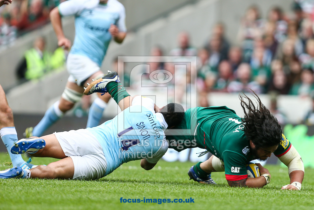 Sinoti Sinoti of Newcastle Falcons (left)  tackles Logovi'i Mulipola of Leicester Tigers (right) during the Aviva Premiership match at Welford Road, Leicester<br /> Picture by Andy Kearns/Focus Images Ltd 0781 864 4264<br /> 06/09/2014