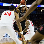 15 March 2018: San Diego State Aztecs forward Malik Pope (21) takes a jump shot over Houston Cougars guard Corey Davis Jr. (5) in the first half. The San Diego State Aztecs got knocked out in the first round by Houston on a last second layup to lose 67-65  at Intrust Bank Arena in Wichita, Kansas.