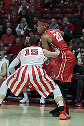 15 February 2014:  Tyshon Pickett picks up his dribble and looks to pass after being cornered by Nick Zeisloft during an NCAA Missouri Valley Conference (MVC) mens basketball game between the Bradley Braves and the Illinois State Redbirds  in Redbird Arena, Normal IL.