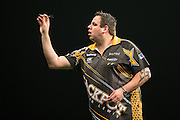 Adrian Lewis in action during the Premier League Darts  at the Motorpoint Arena, Cardiff, Wales on 31 March 2016. Photo by Shane Healey.