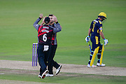 Jim Allenby and Lewis Gregory of Somerset celebrate the wicket of Will Smith of Hampshire and  during the Royal London One Day Cup match between Hampshire County Cricket Club and Somerset County Cricket Club at the Ageas Bowl, Southampton, United Kingdom on 2 August 2016. Photo by David Vokes.