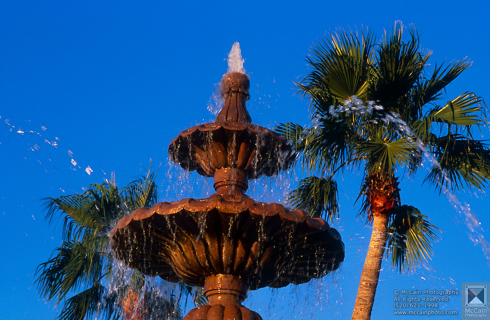 Fountain at resort with palm trees in background, Scottsdale, Arizona..Subject photograph(s) are copyright Edward McCain. All rights are reserved except those specifically granted by Edward McCain in writing prior to publication...McCain Photography.211 S 4th Avenue.Tucson, AZ 85701-2103.(520) 623-1998.mobile: (520) 990-0999.fax: (520) 623-1190.http://www.mccainphoto.com.edward@mccainphoto.com
