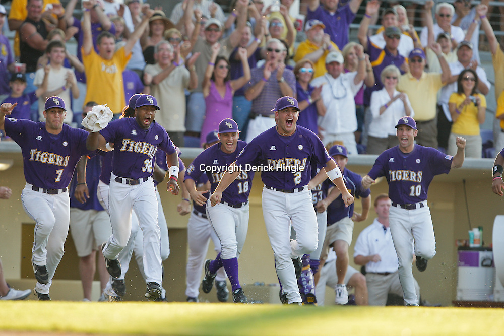 06 June 2009:  Buzzy Haydel (2) of LSU leads the bench as players charge the pitchers mound in celebration following a 5-3 victory by the LSU Tigers over the Rice Owls in game two of the NCAA baseball College World Series, Super Regional played at Alex Box Stadium in Baton Rouge, Louisiana. The Tigers with the win advance to next week's College Baseball World Series in Omaha, Nebraska.