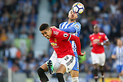 Manchester United Defender Chris Smalling battles for header with Brighton and Hove Albion forward Glenn Murray (17) during the Premier League match between Brighton and Hove Albion and Manchester United at the American Express Community Stadium, Brighton and Hove, England on 4 May 2018. Picture by Phil Duncan.