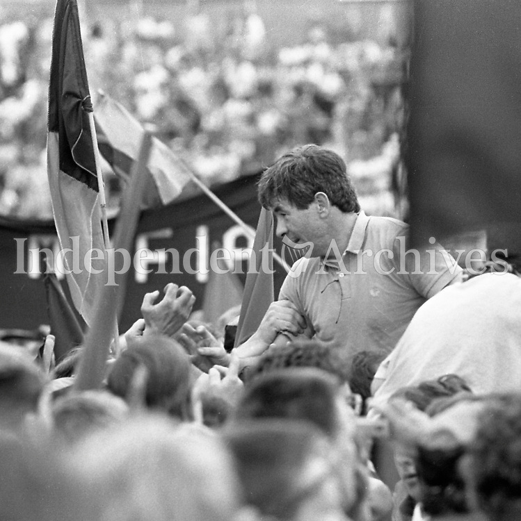 991-328<br /> All Ireland Football Final<br /> Down 1-16 Meath 1-14.<br /> Down Manager Peter McGrath is held up high by fans as he makes his way to the dressing room.<br /> September 15th 1991<br /> Pic: Liam Mulcahy<br /> (Part of the Independent Newspapers Ireland/NLI Collection)