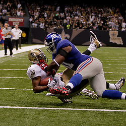 2009 October 18: New York Giants defensive end Justin Tuck (91) tackles New Orleans Saints wide receiver Robert Meachem (17) during a 48-27 win by the New Orleans Saints over the New York Giants at the Louisiana Superdome in New Orleans, Louisiana.