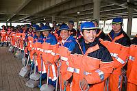 Chinese sweepers ready to start work at Shanghai Expo 2010.<br /> <br /> Les armees de balayeurs du site de Shanghai Expo dont certains utilisent encore des balais de feuilles.