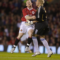 Manchester, England - Tuesday, March 13, 2007: Manchester United's Wayne Rooney scores the opening goal against Europe XI's goalkeeper Santiagio Canizares during the UEFA Celebration Match at Old Trafford. (Pic by David Rawcliffe/Propaganda)