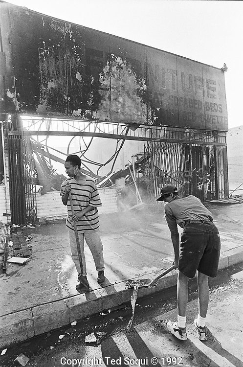 Residents of South Central Los Angeles clean up after the rioting on S.Vermont Ave.