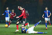 Shrewsbury Town FC midfielder Louis Dodds avoids the sliding tackle from Keith Keane of Rochdale FC (18) during the EFL Sky Bet League 1 match between Rochdale and Shrewsbury Town at Spotland, Rochdale, England on 30 December 2016. Photo by Simon Brady.