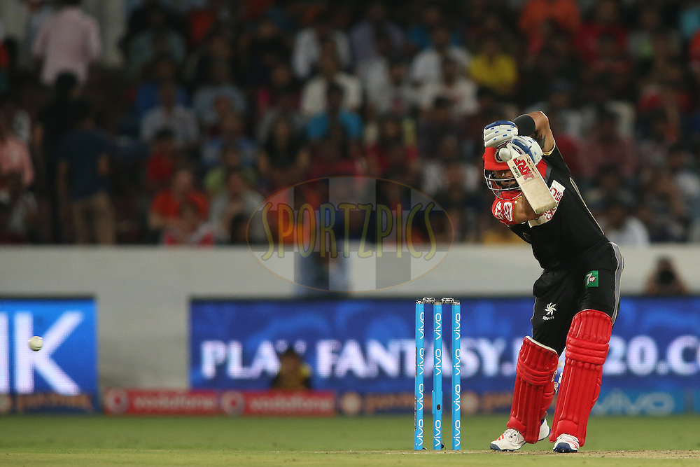 Royal Challengers Bangalore captain Virat Kohli square drives a delivery during match 27 of the Vivo IPL 2016 (Indian Premier League) between the Sunrisers Hyderabad and the Royal Challengers Bangalore held at the Rajiv Gandhi Intl. Cricket Stadium, Hyderabad on the 30th April 2016<br /> <br /> Photo by Shaun Roy / IPL/ SPORTZPICS