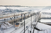 Eurostar train crosses Medway Viaducts in Kent during heavy snow