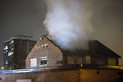 © Licensed to London News Pictures . 05/11/2015 . Manchester , UK . Billy Greens pub on Talgarth Road in North Manchester is set ablaze . Manchester Fire reports receiving more than 300 calls in less than 7 hours, from 4.30pm, including to buildings, cars and wheelie bins set alight by arsonists . At some calls fire crews were subject to vandalism , including a hose being sliced whilst it was being used to fight a fire in Leigh and bricks being thrown at crews attending a job in Miles Platting . Fire crews deal with arson attacks across Greater Manchester during Bonfire Night . Photo credit : Joel Goodman/LNP