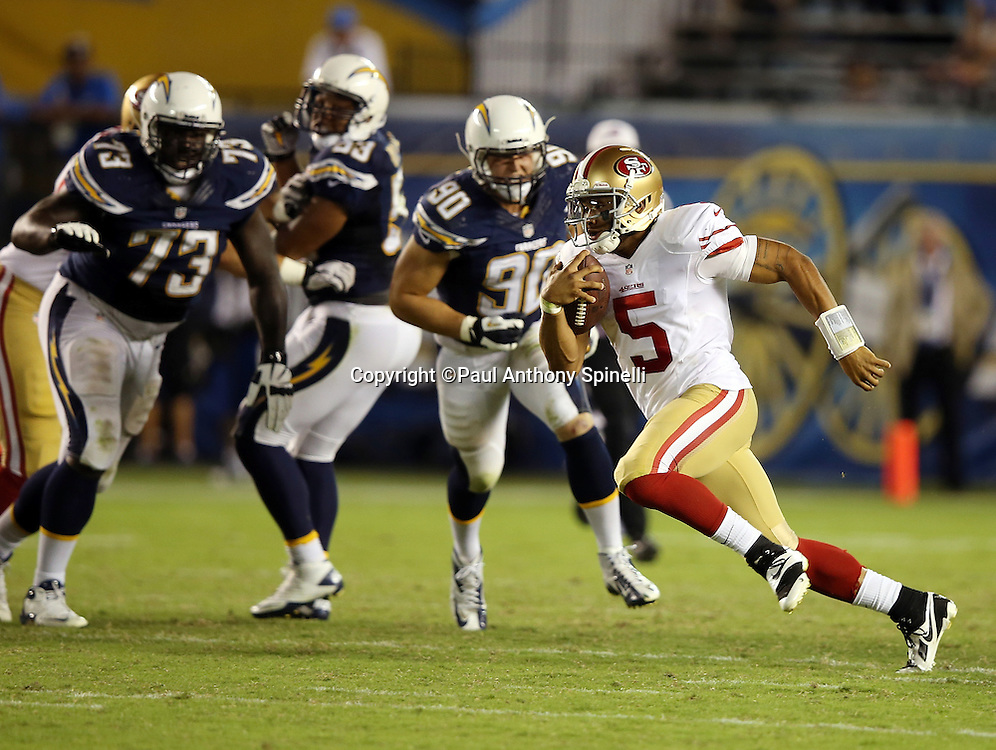 San Francisco 49ers quarterback B.J. Daniels (5) runs for a gain of 13 yards and a first down in the fourth quarter during the NFL week 4 preseason football game against the San Diego Chargers on Thursday, Aug. 29, 2013 in San Diego. The 49ers won the game 41-6. ©Paul Anthony Spinelli