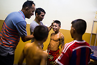 Children of various ages and weight classes get ready before their fights at Thepprasit Stadium in Pattaya, Thailand.